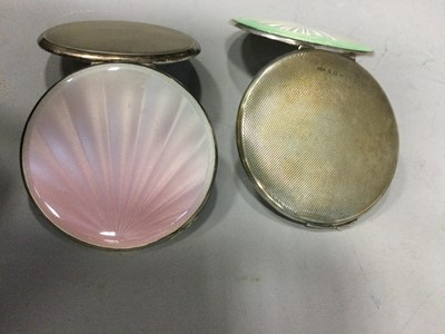 Lot 1719 - AN ATTRACTIVE ENGINE TURNED SILVER AND GUILLOCHE ENAMEL CIRCULAR COMPACT AND ANOTHER