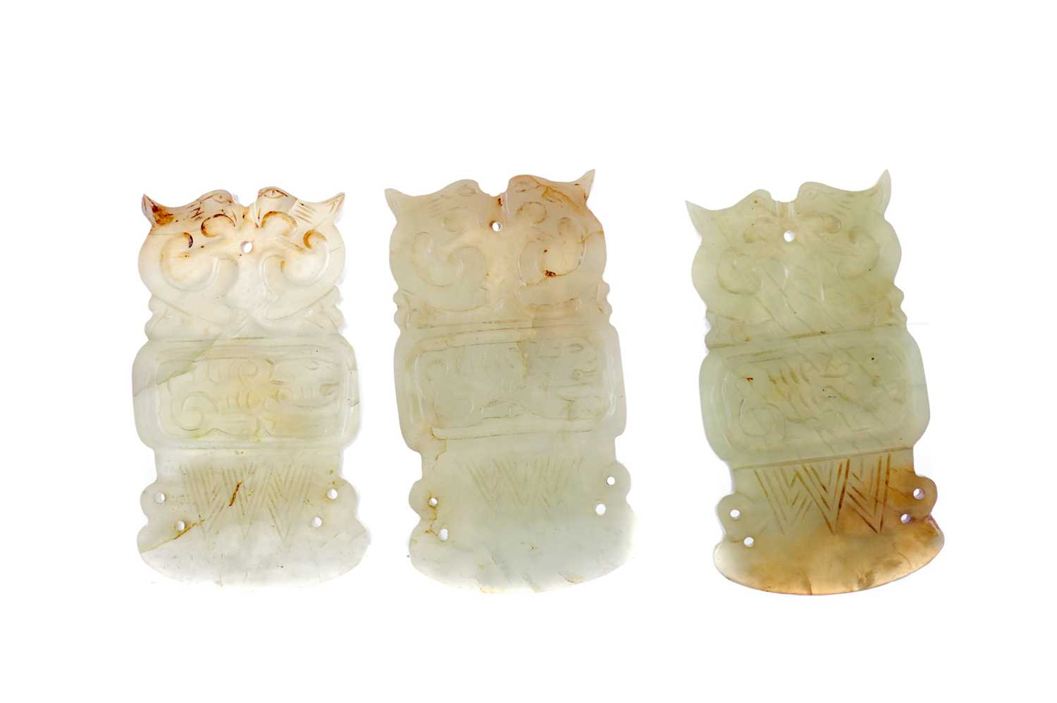 Lot 772 - A SET OF THREE CHINESE ARCHAIC STYLE HARDSTONE AMULETS