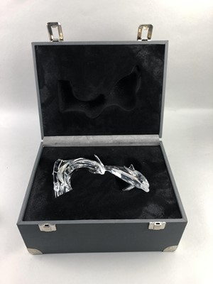 Lot 142 - A SWAROVSKI SILVER CRYSTAL FIGURE OF A DOLPHIN AND THREE OTHER SMALLER FISH FIGURES