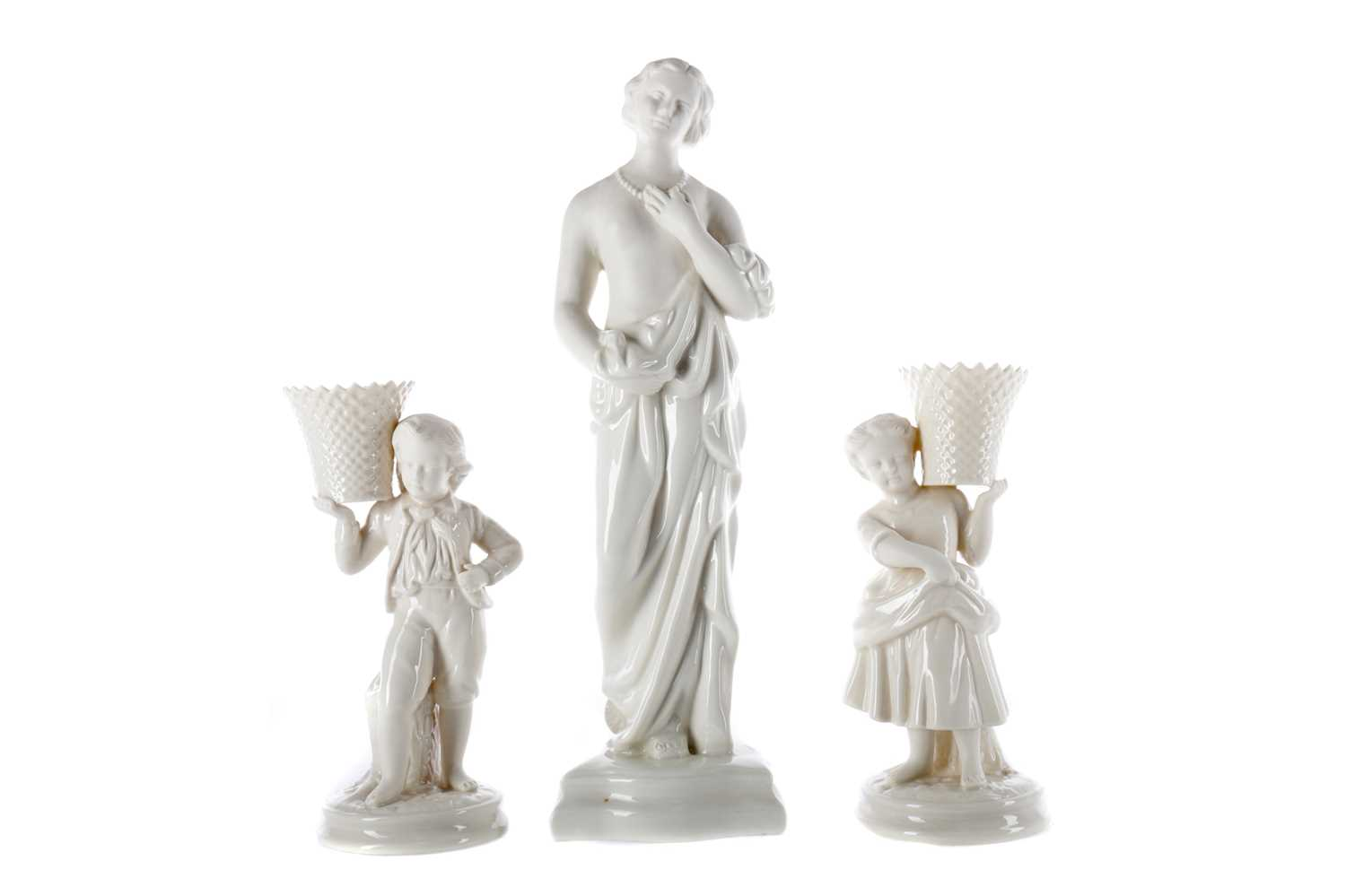 Lot 1102 - A BELLEEK FIGURE OF MEDITATION ALONG WITH A PAIR OF FIGURES