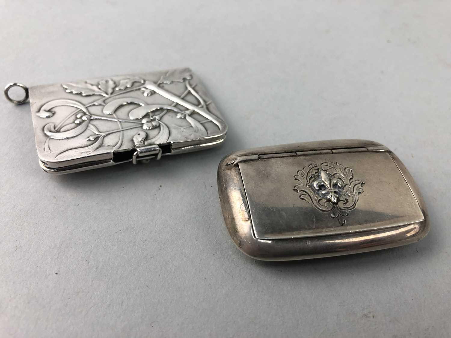 Lot 43 - A 19TH CENTURY SILVER PILL BOX AND A SILVER MATCH HOLDER