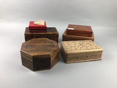 Lot 47 - A LOT OF SIX CARVED WOODEN BOXES AND A MASK
