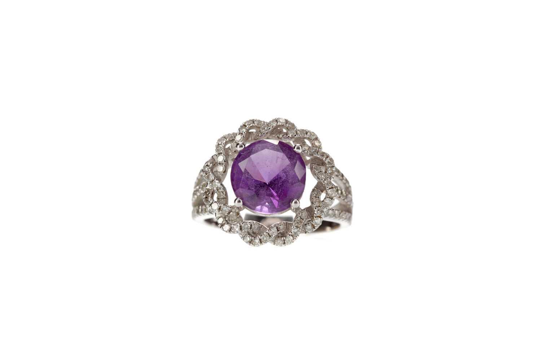 Lot 309 - PURPLE GEM AND DIAMOND SET RING