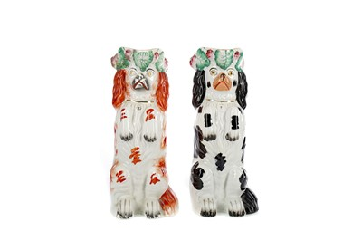 Lot 1013 - A NEAR PAIR OF MID-19TH CENTURY STAFFORDSHIRE BEGGING DOG JUGS