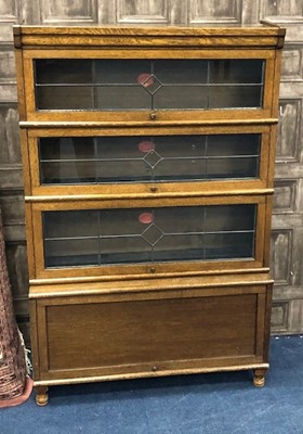 Lot 77 - AN OAK SECTIONAL BOOKCASE