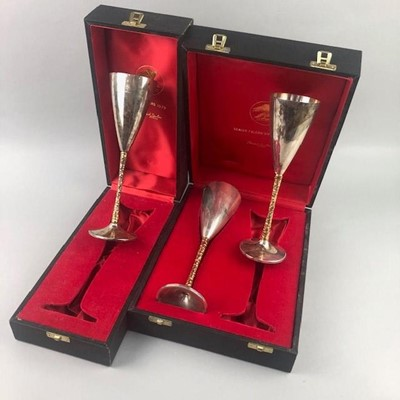 Lot 108 - A PAIR OF SILVER CHAMPAGNE FLUTES AND ANOTHER
