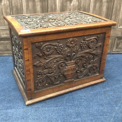 Lot 1 - A 20TH CENTURY CARVED OAK LOG BOX