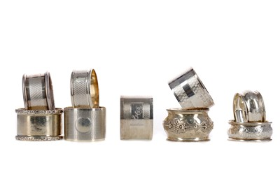 Lot 407 - A COLLECTION OF EIGHT SILVER NAPKIN RINGS