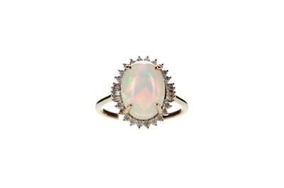Lot 328 - AN OPAL AND DIAMOND RING