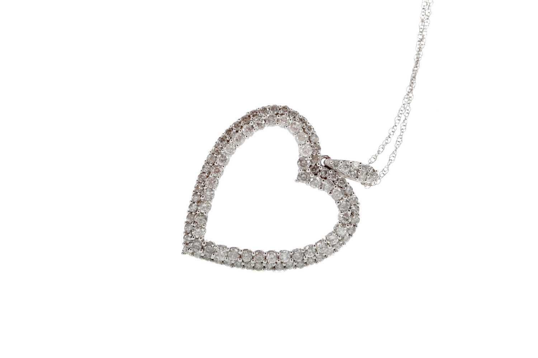 Lot 335 - A HEART SHAPED DIAMOND PENDANT