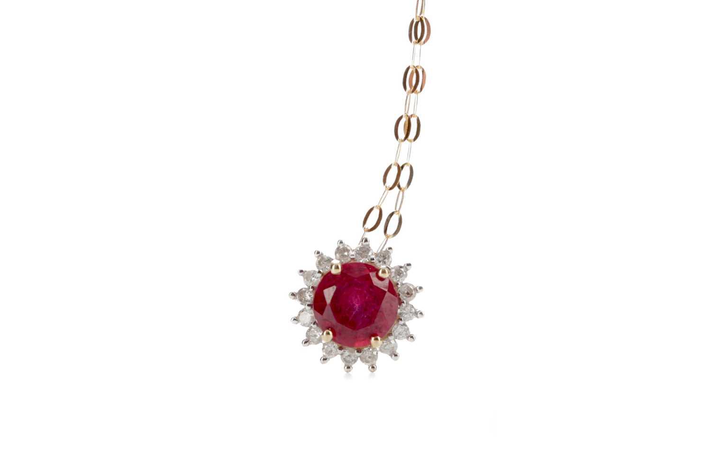 Lot 336 - A RUBY AND DIAMOND PENDANT