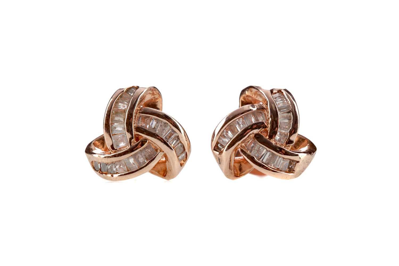 Lot 360 - A PAIR OF DIAMOND KNOT EARRINGS