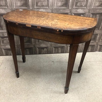 Lot 1657 - A REGENCY MAHOGANY AND ROSEWOOD TURNOVER CARD TABLE