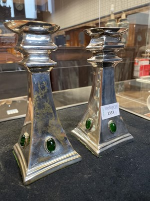 Lot 1333 - A PAIR OF ARTS & CRAFTS CANDLESTICKS