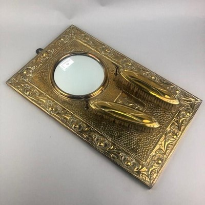 Lot 76 - A BRASS EMBOSSED WALL HANGING MIRROR AND BRUSH SET