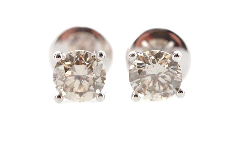 Lot 438 - A PAIR OF DIAMOND STUD EARRINGS