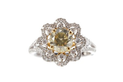 Lot 404 - A DIAMOND DAISY RING