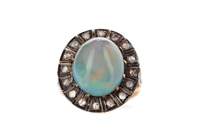 Lot 435 - AN ETHIOPIAN OPAL AND DIAMOND RING