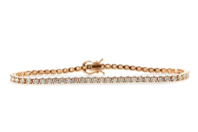 Lot 438 - A DIAMOND TENNIS BRACELET