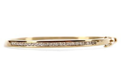 Lot 467 - A DIAMOND BANGLE