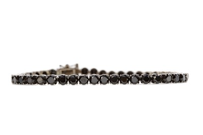 Lot 471 - A BLACK DIAMOND LINE BRACELET