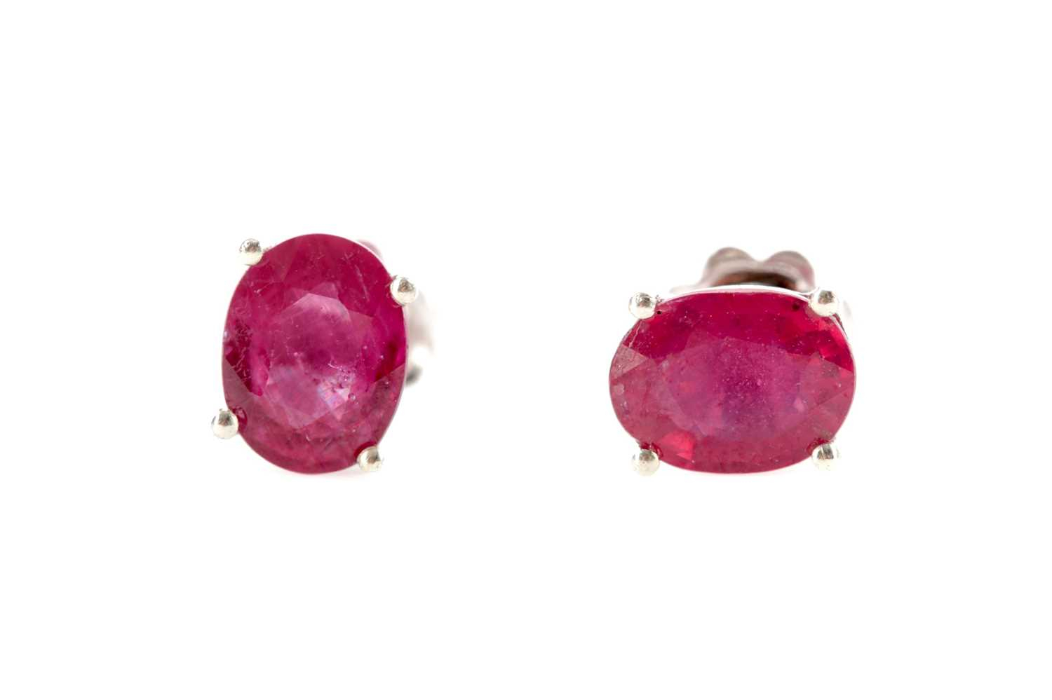 Lot 517 - A PAIR OF TREATED RUBY EARRINGS