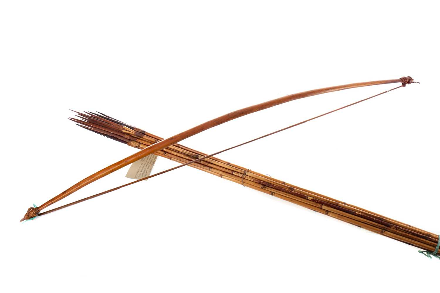 Lot 1334 - A 20TH CENTURY DANI TRIBAL BOW AND ARROWS