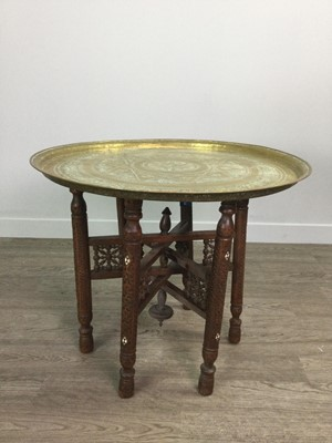 Lot 732 - AN INDIAN BRASS TABLE ON FOLDING STAND