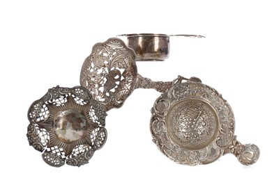 Lot 419 - A LOT OF THREE SILVER TEA STRAINERS, AND A BONBON DISH