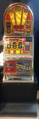 Lot 40 - A CASINO MODEL, DOME TOPPED 'THE STREAK' £25 JACKPOT FRUIT MACHINE