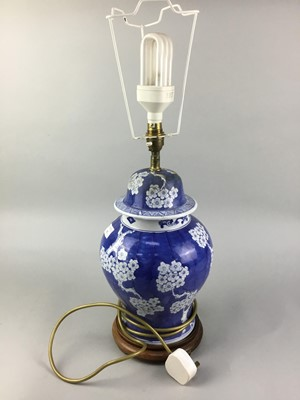 Lot 102 - A BLUE AND WHITE CERAMIC TABLE LAMP AND THREE OTHERS