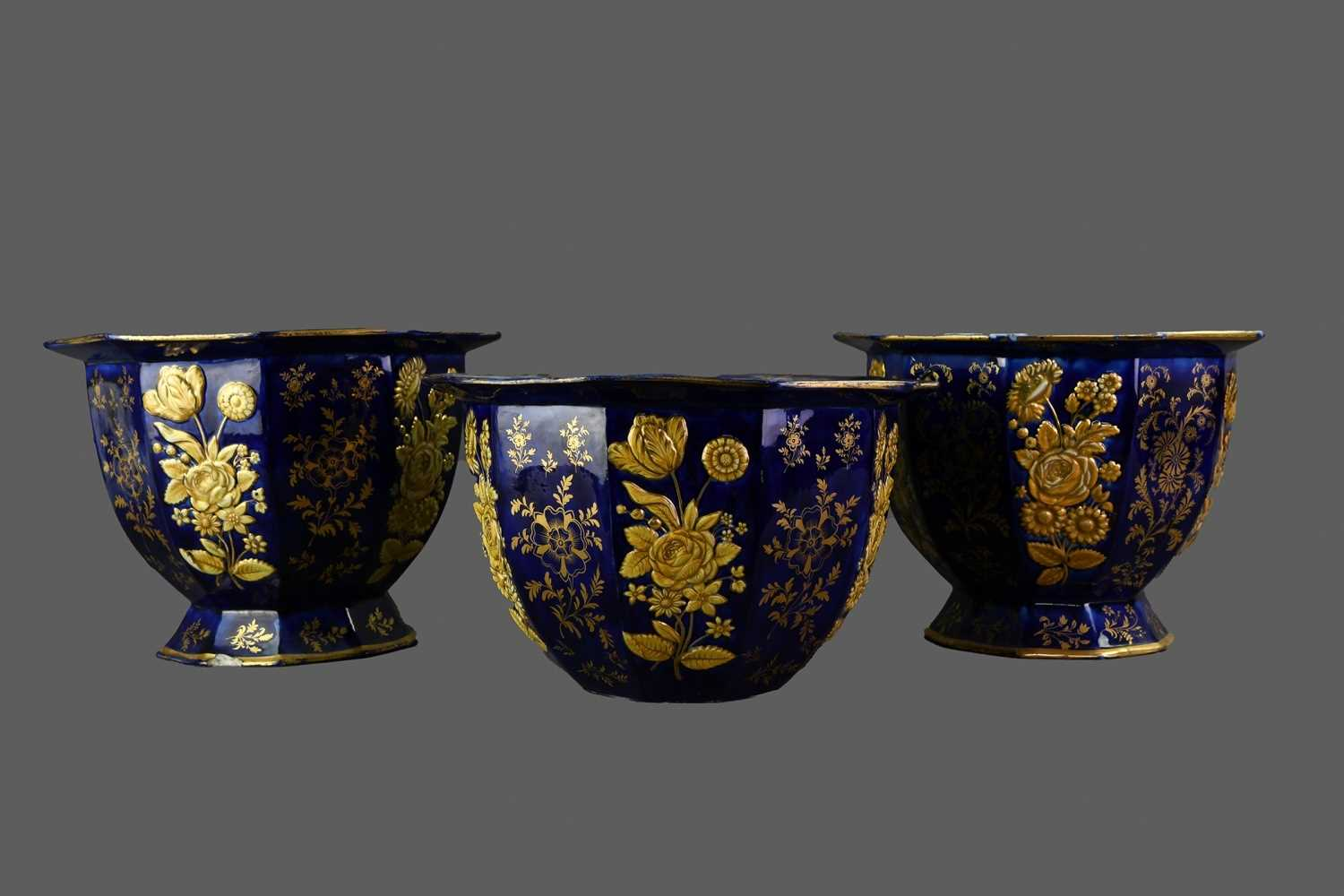 Lot 89 - AN EARLY 20TH CENTURY GARNITURE OF THREE STONEWARE PLANTERS
