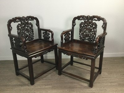 Lot 767 - A PAIR OF CHINESE IRONWOOD ARMCHAIRS