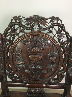 Lot 768 - A CHINESE IRONWOOD ARMCHAIR