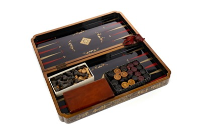 Lot 718 - AN EARLY 20TH CENTURY JAPANNED GAMES BOARD