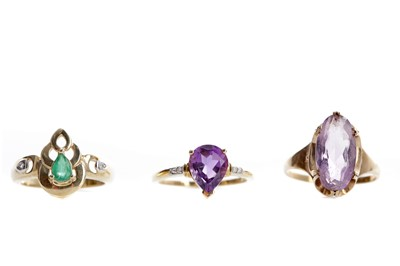 Lot 549 - TWO PURPLE GEM SET AND DIAMOND RINGS AND A GREEN GEM SET AND DIAMOND RING