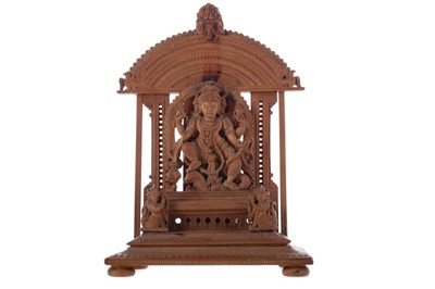 Lot 336 - AN EARLY 20TH CENTURY INDIAN CARVED SANDALWOOD FIGURE OF A DEITY