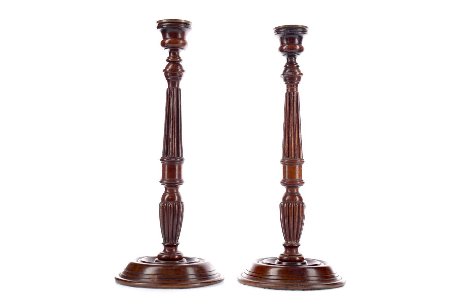 Lot 57 - A PAIR OF GEORGE III STYLE MAHOGANY CANDLESTICKS