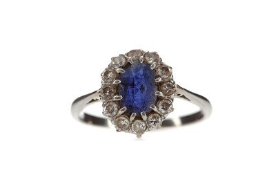Lot 303 - A BLUE GEM SET AND DIAMOND CLUSTER RING