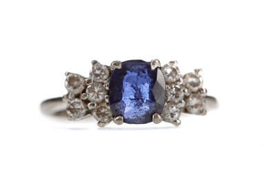 Lot 304 - A BLUE GEM SET AND DIAMOND RING