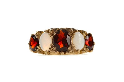 Lot 491 - A RED GEM SET AND OPAL RING