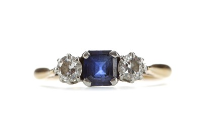 Lot 547 - A SAPPHIRE AND DIAMOND THREE STONE RING