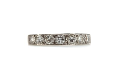 Lot 552 - DIAMOND HALF HOOP ETERNITY RING, set with a...