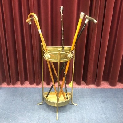 Lot 2 - A BRASS SEMI CIRCULAR STICK STAND AND VARIOUS STICKS AND CANES