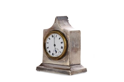 Lot 454 - AN EARLY 20TH CENTURY SILVER CASED BEDSIDE TIMEPIECE