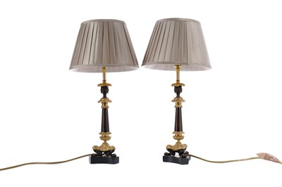 Lot 1607 - A PAIR OF REGENCY PATINATED AND GILDED BRONZE CANDLESTICKS CONVERTED TO LAMPS