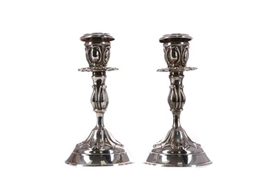 Lot 448 - A PAIR OF CONTINENTAL ARTS & CRAFTS SILVER CANDLESTICKS