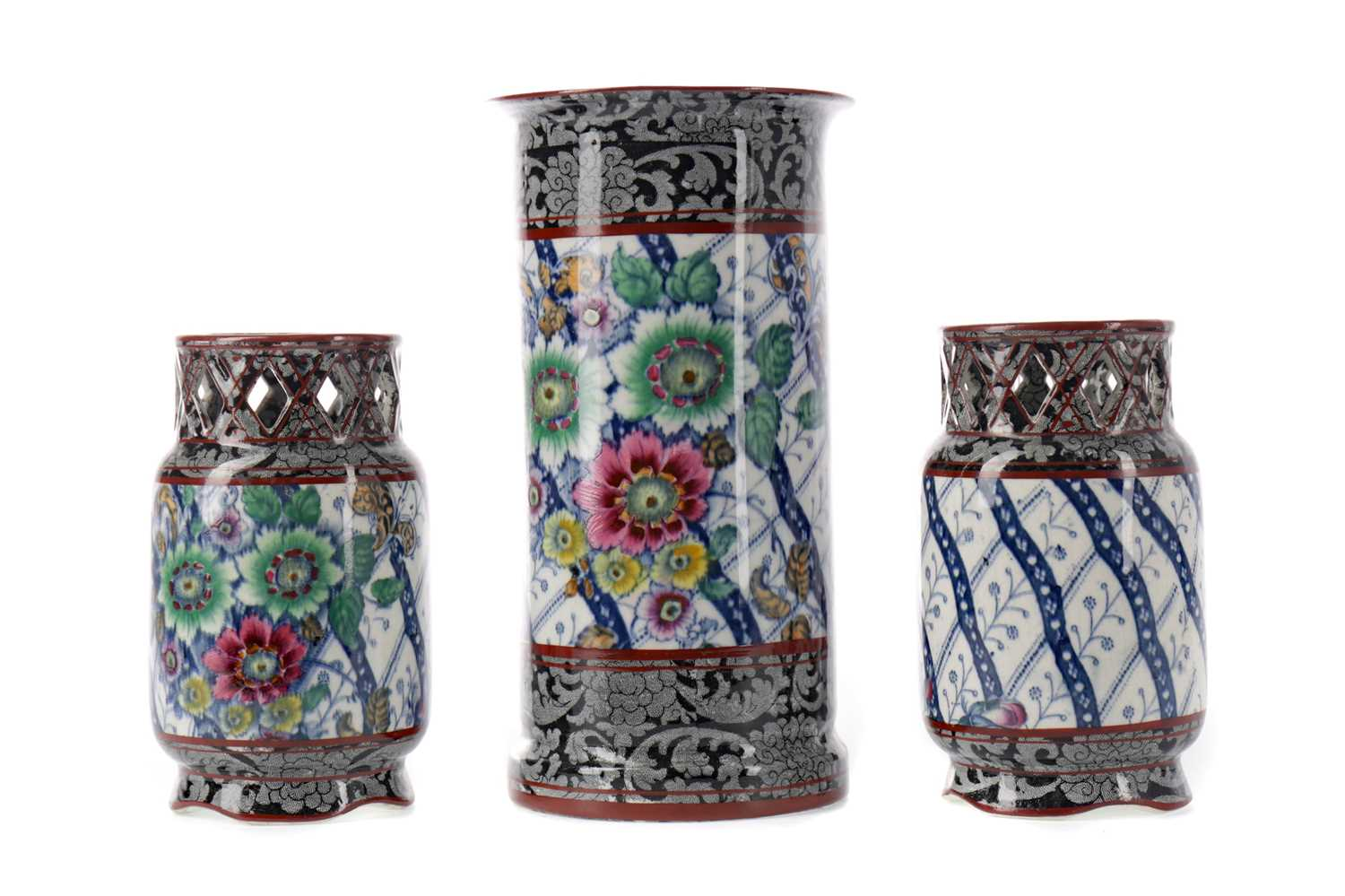 Lot 65 - A GARNITURE OF THREE LATE VICTORIAN EARTHENWARE SPILL VASES
