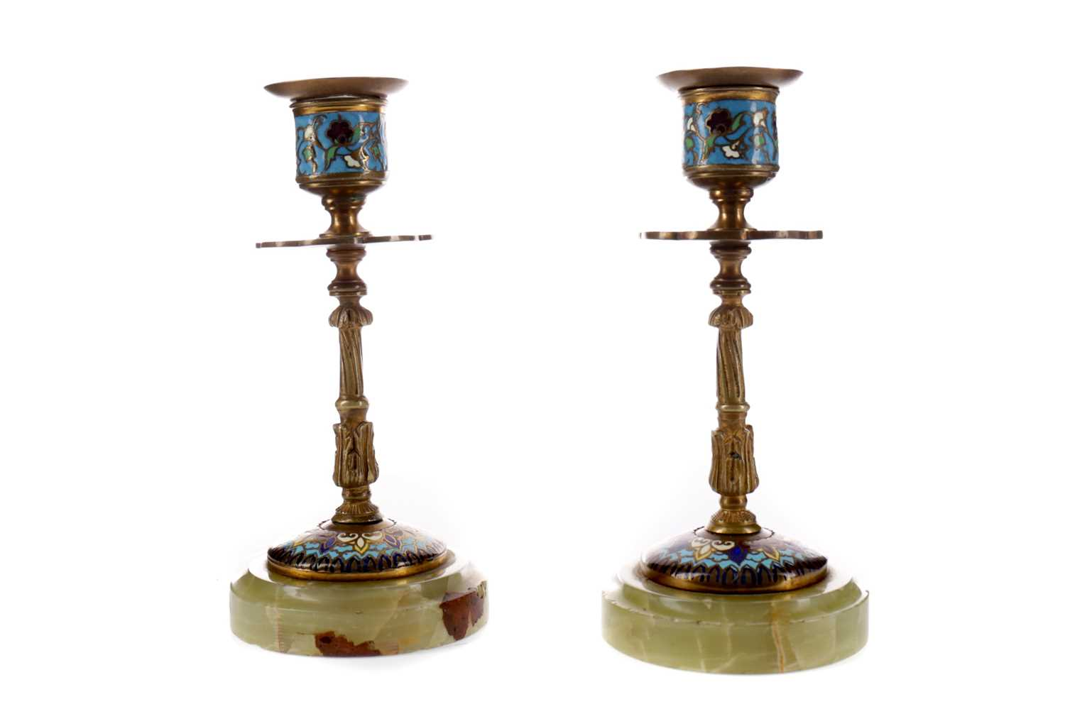 Lot 63 - A PAIR OF LATE 19TH CENTURY BRASS AND CHAMPLEVÉ ENAMEL CANDLESTICKS
