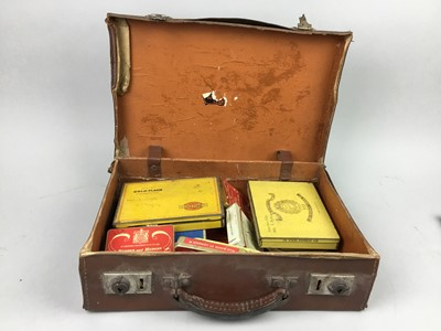 Lot 10 - A COLLECTION OF VINTAGE CIGARETTE TINS, ALONG WITH THREE STAMP ALBUMS